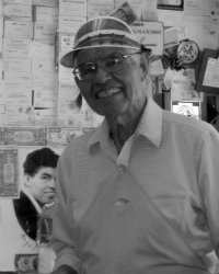 Angel Delgadillo in his barber shop on Route 66 in Seligman Arizona